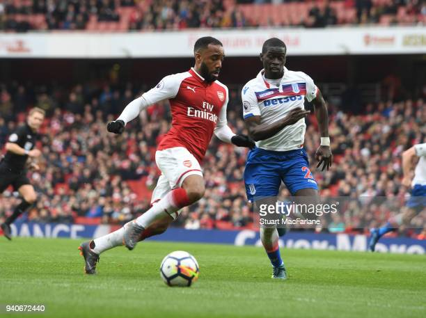 Alex Lacazette of Arsenal takes on Badou Ndiaye of Stoke during the Premier League match between Arsenal and Stoke City at Emirates Stadium on April...