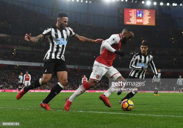 Alex Lacazette of Arsenal takes on Jamaal Lascelles of Newcastle during the Premier League match between Arsenal and Newcastle United at Emirates...