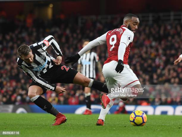 Alex Lacazette of Arsenal takes on Joselu of Newcastle during the Premier League match between Arsenal and Newcastle United at Emirates Stadium on...