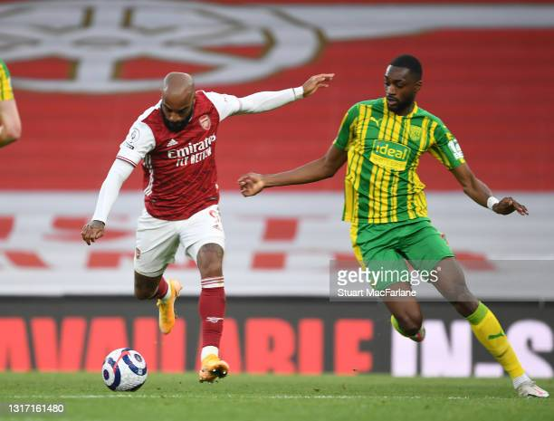 Alex Lacazette of Arsenal takes on Semi Ajayi of West Brom during the Premier League match between Arsenal and West Bromwich Albion at Emirates...