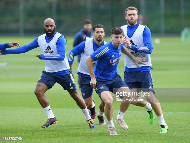 Alex Lacazette, Pablo Mari, Kieran Tierney and Calum Chambers of Arsenal during a training session at London Colney on May 18, 2021 in St Albans,...
