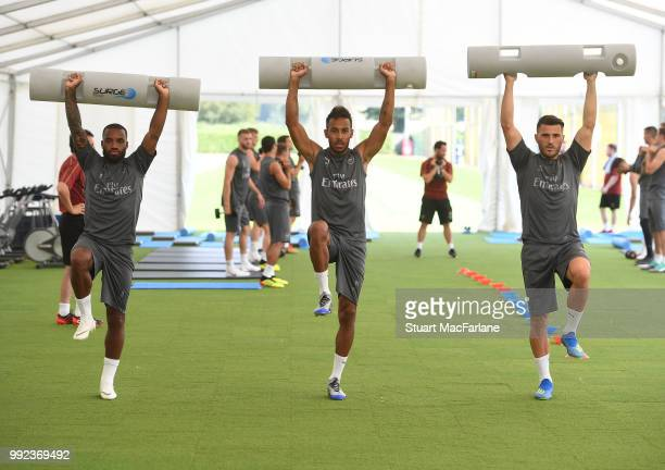 Alex Lacazette PierreEmerick Aubameyang and Sead Kolasinac of Arsenal during a training session at London Colney on July 5 2018 in St Albans England
