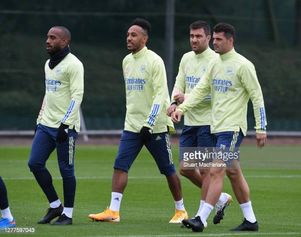 Alex Lacazette PierreEmerick Aubameyang Sokratis and Granit Xhaka of Arsenal before a training session at London Colney on September 30 2020 in St...