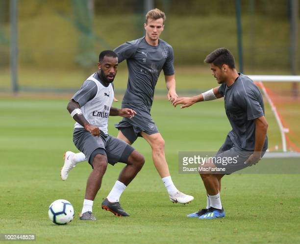 Alex Lacazette Rob Holding and Konstantinos Mavropanos of Arsenal during a training session at London Colney on July 20 2018 in St Albans England