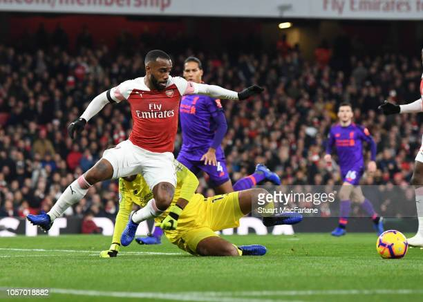 Alex Lacazette rounds Liverpool goalkeeper Alisson to score the Arsenal goal during the Premier League match between Arsenal FC and Liverpool FC at...