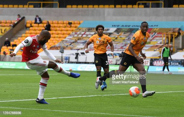 Alex Lacazette scores the 2nd Arsenal goal during the Premier League match between Wolverhampton Wanderers and Arsenal FC at Molineux on July 04,...