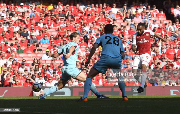 Alex Lacazette shoots past Burley goalkeeper Nick Pope to score the 2nd Arsenal goal during the Premier League match between Arsenal and Burnley at...
