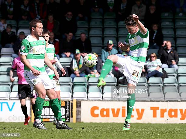 Alex Lacey of Yeovil Town looks to clear the ball during the Sky Bet League Two match between Yeovil Town and Northampton Town at Huish Park on April...