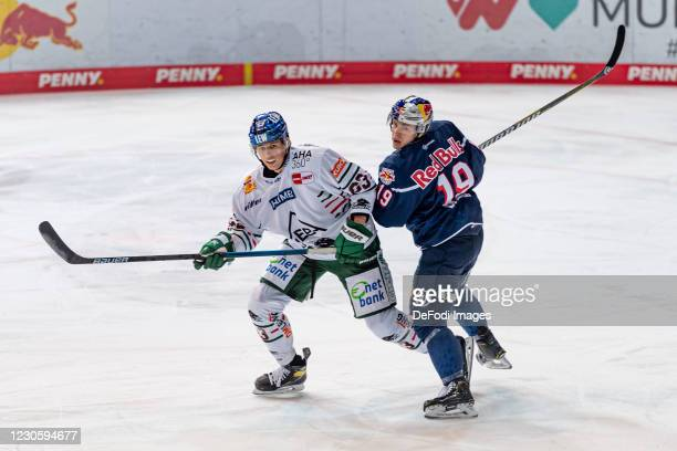 Alex Lambacher of Augsburger Panther and Dennis Lobach of EHC Red Bull Muenchen battle for the puck during the DEL match between EHC Red Bull...