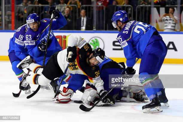 Alex Lambacher of Italy challenges Yannic Seidenberg of Germany for the puck during the 2017 IIHF Ice Hockey World Championship game between Italy...