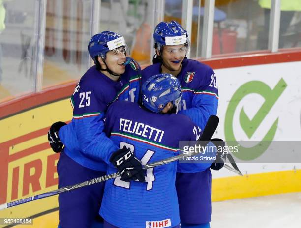 Alex Lambacher of Italy Luca Felicetti of Italy and Ivan Deluca of Italy celebrate the first Italian score during the 2018 IIHF Ice Hockey World...
