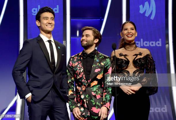 Alex Landi Jake Borelli and Olivia Munn speak onstage during the 30th Annual GLAAD Media Awards Los Angeles at The Beverly Hilton Hotel on March 28...