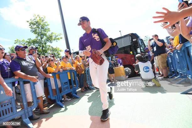 Alex Lange of Louisiana State University arrives off of the team bus before his team takes on the University of Florida during the Division I Men's...