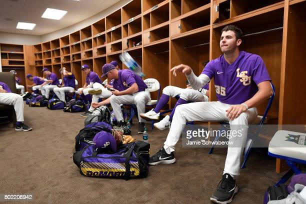 Alex Lange of Louisiana State University flips a water bottle in the locker room before his team takes on the University of Florida during the...