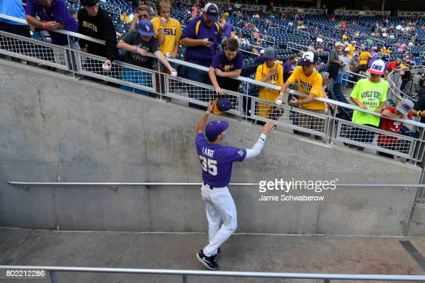Alex Lange of Louisiana State University shakes hands with fans as his team takes on the University of Florida during the Division I Men's Baseball...