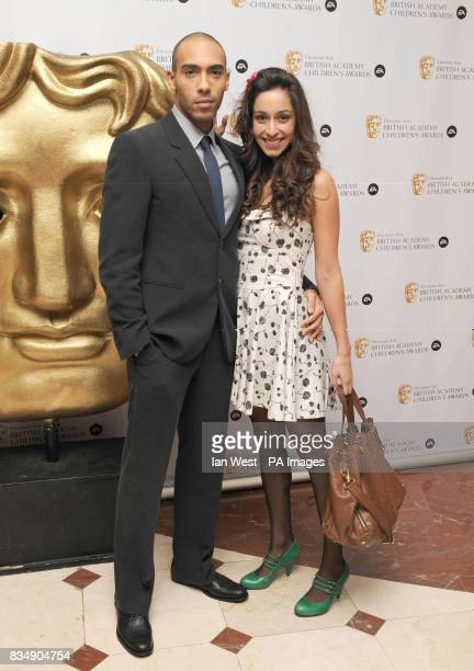 Alex Lanipekun and guest arrive at the EA BAFTA Kids Awards at the Hilton Hotel in London