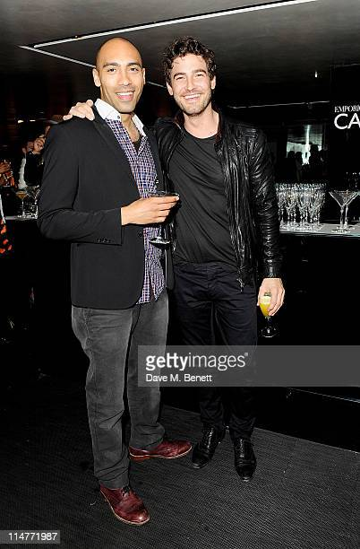 Alex Lanipekun and Robert Konjic attend the launch of the summer menu at the Emporio Armani Caffe on May 26 2011 in London England