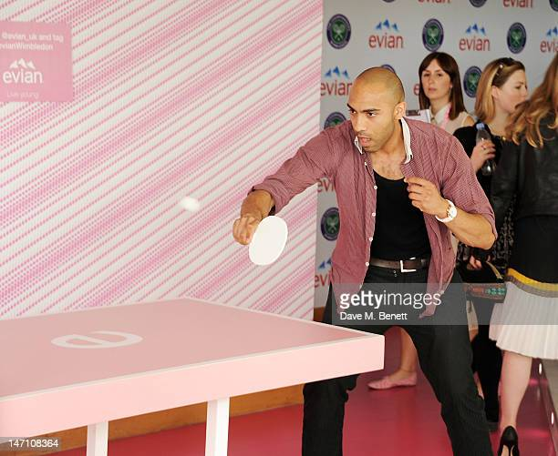 Alex Lanipekun plays table tennis at the evian 'Live young' VIP Suite at Wimbledon on June 25 2012 in London England