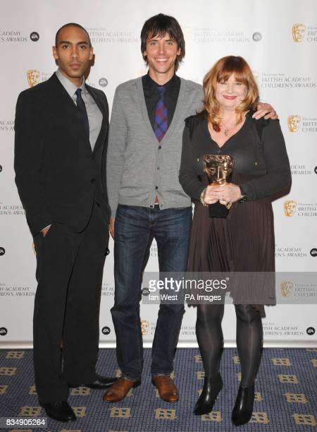 Alex Lanipekun with Anne Gilchrist and unidentified man the Channel of the Year Award for CBBC at the EA BAFTA Kid's Awards at the Hilton Hotel in...