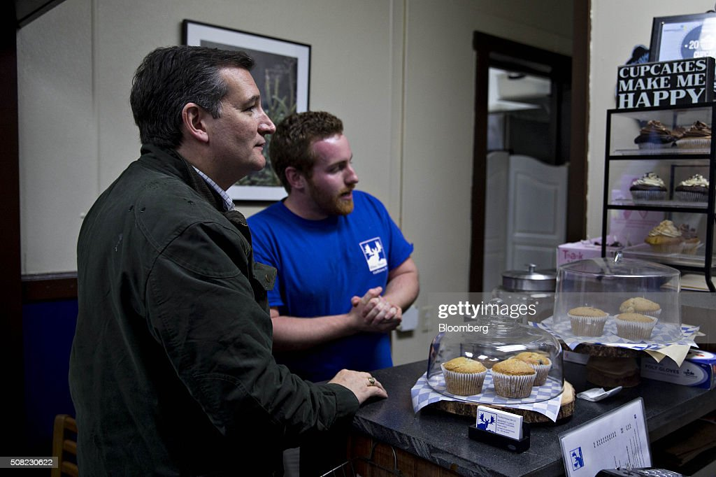 Alex Lapointe, owner of the Blue Moose Cafe, explains cupcake varieties to Senator Ted Cruz, a Republican from Texas and 2016 presidential candidate, left, as Cruz claims his free cupcake after a campaign stop in Goffstown, New Hampshire, U.S., on Wednesday, Feb. 3, 2016. Republican presidential candidate Donald Trump on Wednesday said Cruz 'stole' first place in the Iowa caucuses and called for 'a new election' or nullification of Cruz's win. Photographer: Andrew Harrer/Bloomberg via Getty Images