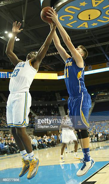 Alex Larsson of the UC Riverside Highlanders fights for a rebound against Tony Parker of the UCLA Bruins at Pauley Pavilion on December 10 2014 in...