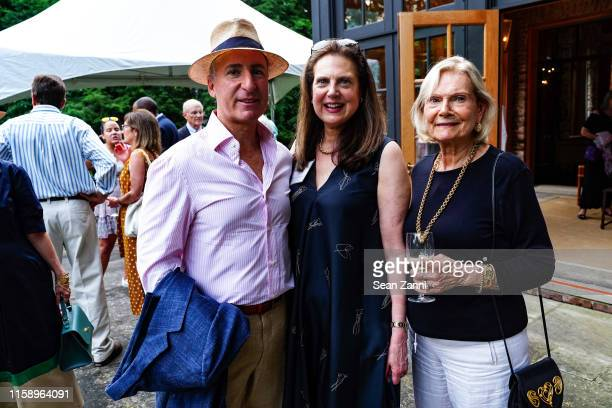 Alex Latzer Andrea Hart and Joan Grace attend A Country House Gathering To Benefit Preservation Long Island on June 28 2019 in Locust Valley New York