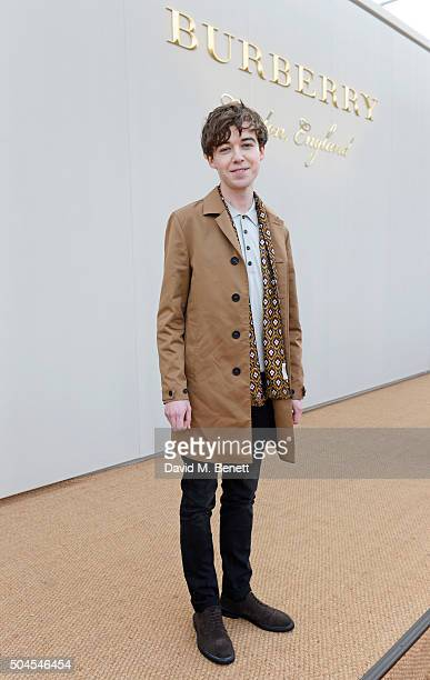 Alex Lawther attends the Burberry Menswear January 2016 Show on January 11 2016 in London United Kingdom