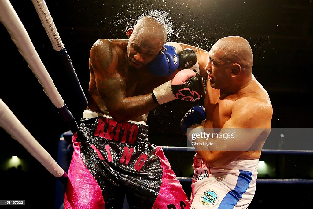 Alex Leapai of Australia punches Malik Scott of the USA during the heavyweight fight at the Logan Metro Sports Centre on October 31, 2014 in Brisbane, Australia.