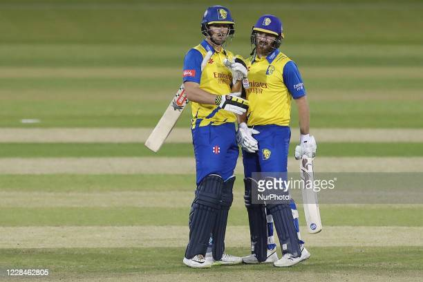 Alex Lees of Durham congratulates Ben Raine on making fifty during the Vitality T20 Blast match between Durham County Cricket Club and Derbyshire...