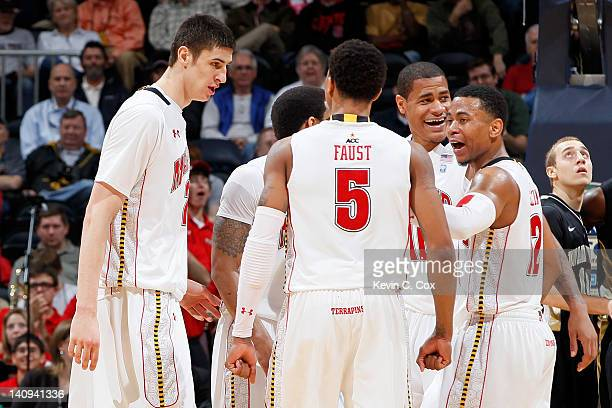 Alex Len Nick Faust Mychal Parker and Terrell Stoglin of the Maryland Terrapins huddle up in the second half against the Wake Forest Demon Deacons...