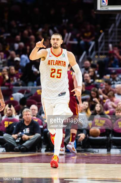 Alex Len of the Atlanta Hawks celebrates after scoring during the second half against the Cleveland Cavaliers at Quicken Loans Arena on October 21...