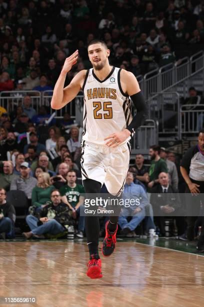 Alex Len of the Atlanta Hawks celebrates three point basket against the Milwaukee Bucks on April 7 2019 at the Fiserv Forum Center in Milwaukee...