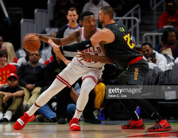 Alex Len of the Atlanta Hawks defends against Wendell Carter Jr #34 of the Chicago Bulls at State Farm Arena on October 27 2018 in Atlanta Georgia...