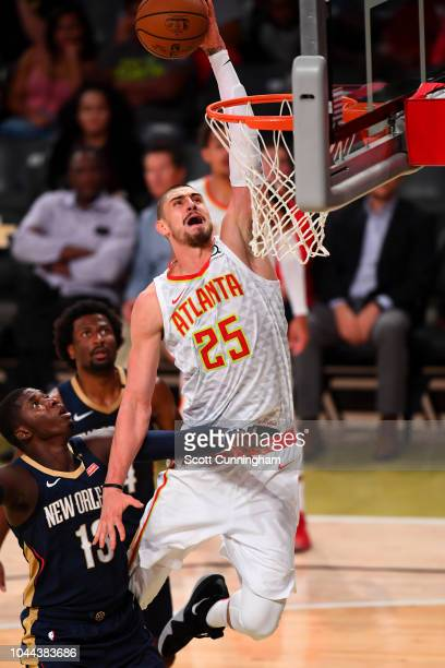 Alex Len of the Atlanta Hawks drives to the basket against the New Orleans Pelicans during a preseason game on October 1 2018 at McCamish Pavilion in...