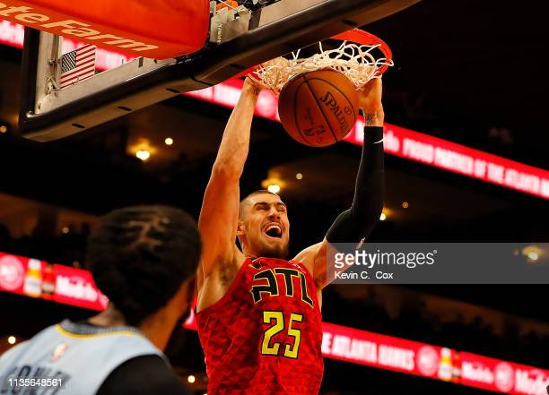 Alex Len of the Atlanta Hawks dunks against the Memphis Grizzlies in the second half at State Farm Arena on March 13 2019 in Atlanta Georgia NOTE TO...