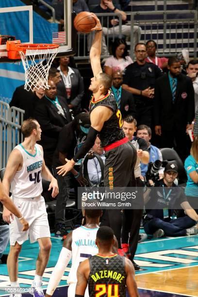 Alex Len of the Atlanta Hawks dunks the ball against the Charlotte Hornets on November 6 2018 at Spectrum Center in Charlotte North Carolina NOTE TO...