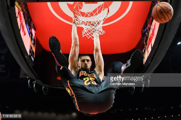 Alex Len of the Atlanta Hawks dunks the ball during the first quarter of a game against the Indiana Pacers at State Farm Arena on January 4 2020 in...