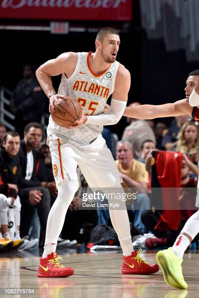 Alex Len of the Atlanta Hawks handles the ball against the Cleveland Cavaliers on October 21 2018 at Quicken Loans Arena in Cleveland Ohio NOTE TO...