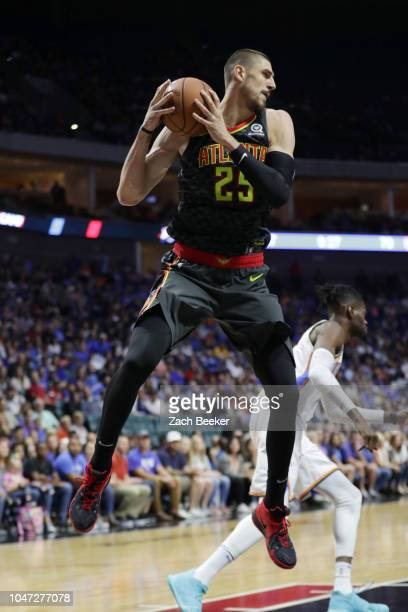 Alex Len of the Atlanta Hawks handles the ball against the Oklahoma City Thunder during a preseason game on October 7 2018 at BOK Center in Tulsa...