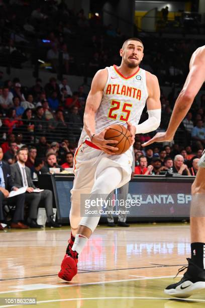Alex Len of the Atlanta Hawks handles the ball against the San Antonio Spurs during a preseason game on October 10 2018 at McCamish Pavilion in...