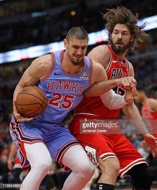 Alex Len of the Atlanta Hawks is fouled by Robin Lopez of the Chicago Bulls at the United Center on March 03 2019 in Chicago Illinois NOTE TO USER...