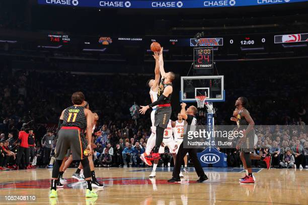 Alex Len of the Atlanta Hawks jumps for tip off to start the game against the New York Knicks during the game on October 17 2018 at Madison Square...