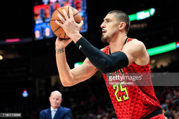 Alex Len of the Atlanta Hawks looks to shoot the ball during a game against the Orlando Magic at State Farm Arena on October 26 2019 in Atlanta...