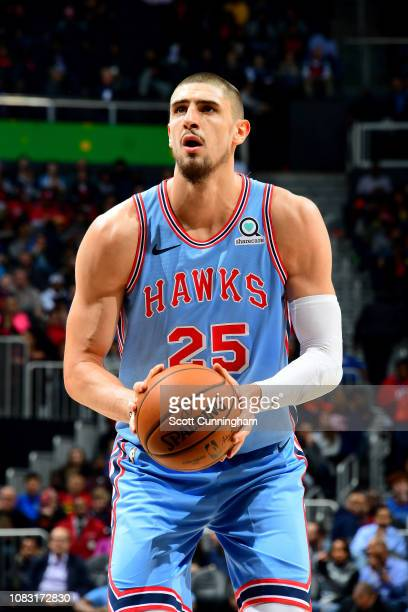 Alex Len of the Atlanta Hawks shoots a free throw during the game against the Oklahoma City Thunder on January 15 2019 at State Farm Arena in Atlanta...