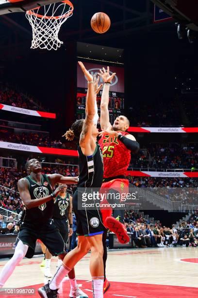 Alex Len of the Atlanta Hawks shoots the ball against the Milwaukee Bucks on January 13 2019 at State Farm Arena in Atlanta Georgia NOTE TO USER User...