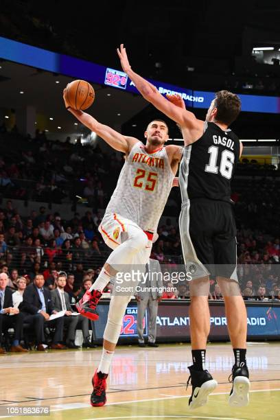 Alex Len of the Atlanta Hawks shoots the ball against the San Antonio Spurs during a preseason game on October 10 2018 at McCamish Pavilion in...