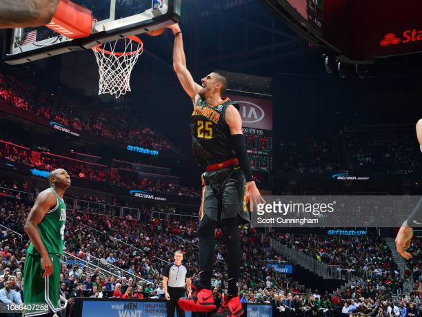 Alex Len of the Atlanta Hawksl dunks the ball against the Boston Celtics on January 19 2019 at State Farm Arena in Atlanta Georgia NOTE TO USER User...