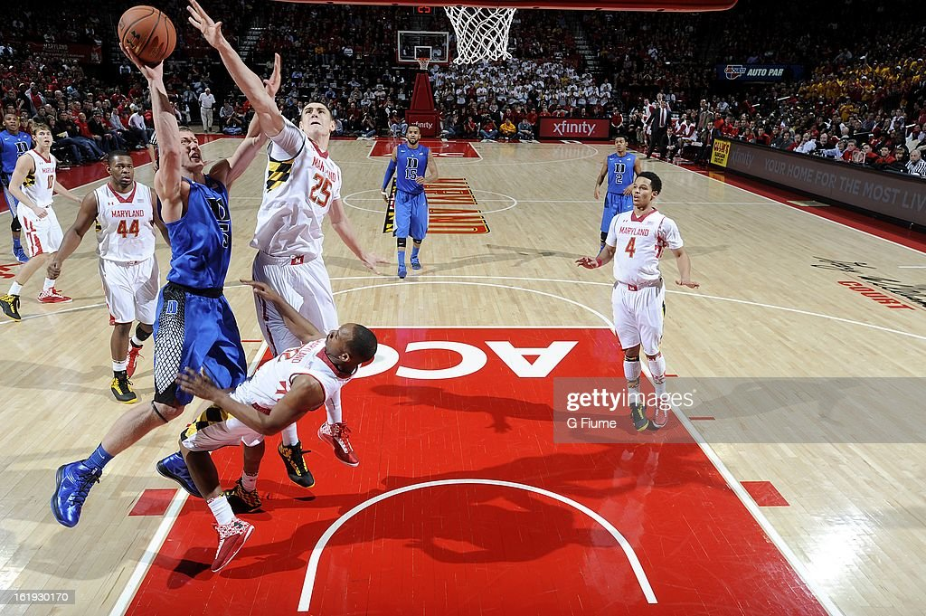 Alex Len #25 of the Maryland Terrapins blocks a shot by Mason Plumlee #5 of the Duke Blue Devils at the Comcast Center on February 16, 2013 in College Park, Maryland. Maryland won the game 83-81.