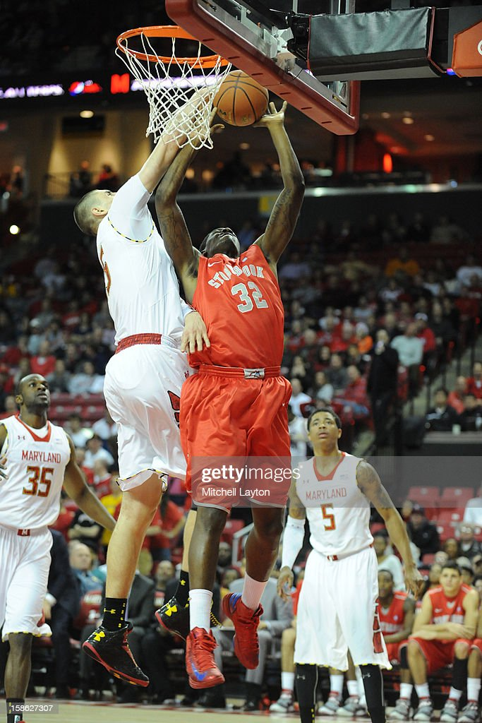 Alex Len #25 of the Maryland Terrapins blocks Anthony Mayo #32 of the Stony Brook Seawolves shot during a college basketball game on December 21, 2012 at the Comcast Center in College Park, Maryland.
