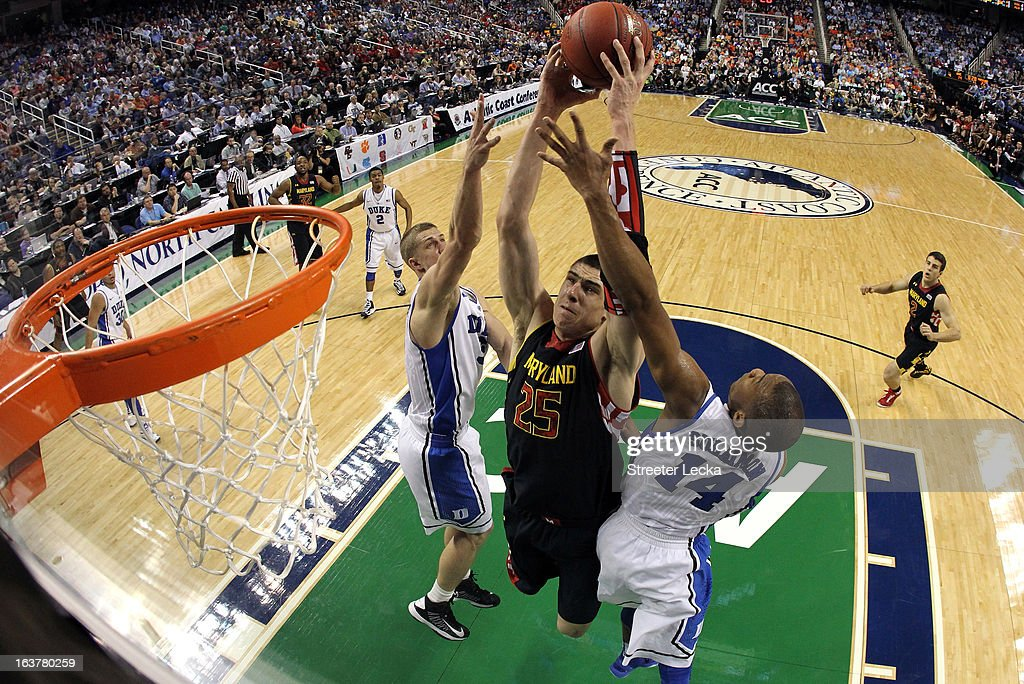 Alex Len #25 of the Maryland Terrapins drives to the basket against teammates Mason Plumlee #5 and Rasheed Sulaimon #14 of the Duke Blue Devils during the quarterfinals of the Men's ACC Basketball Tournament at Greensboro Coliseum on March 15, 2013 in Greensboro, North Carolina.
